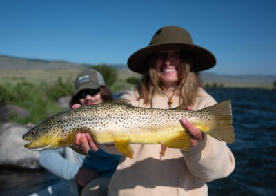 Angler showing off a Madison River Brown Trout
