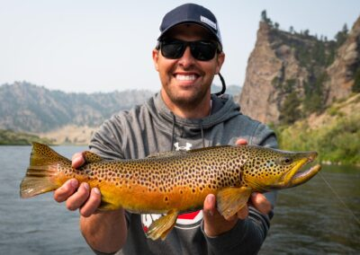 Angler with a trophy brown trout on Montana's Missouri River