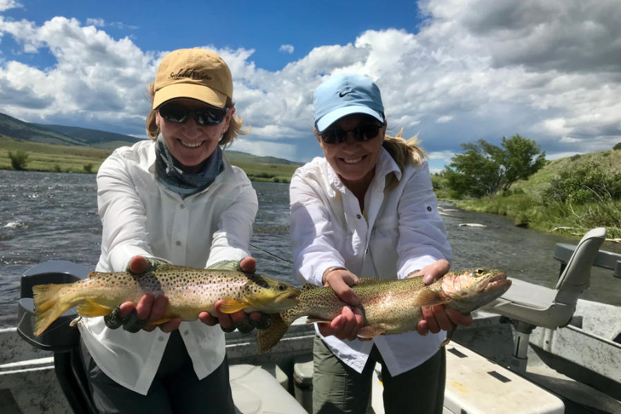 Pair of anglers with a pair of Madison River trout