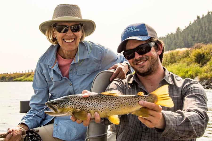 Angler and Fly Fishing Guide with a Yellowstone Brown Trout