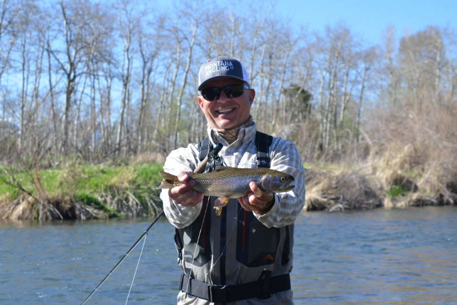 Angler holding a rainbow trout on DePuy's Spring Creek in Montana