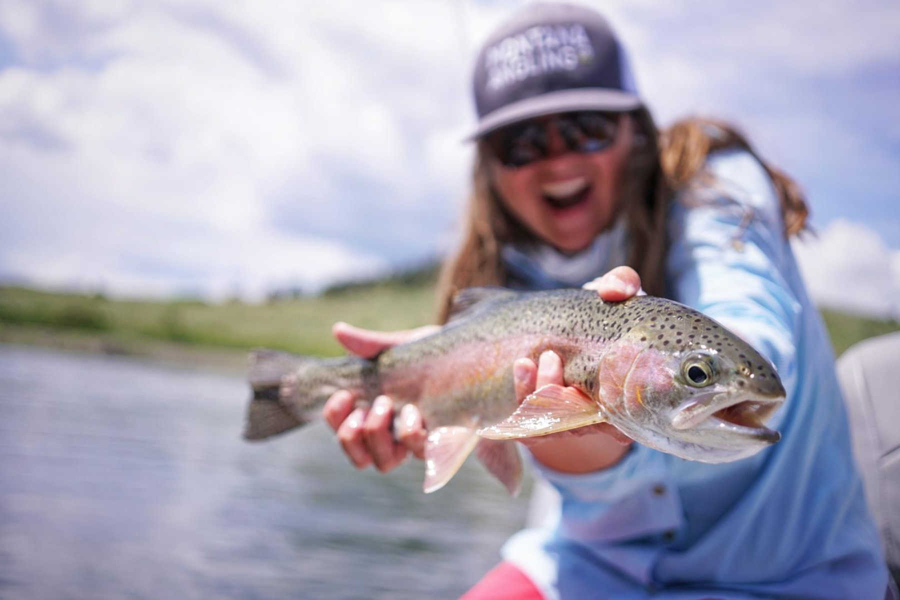 angler with a Missouri River rainbow trout