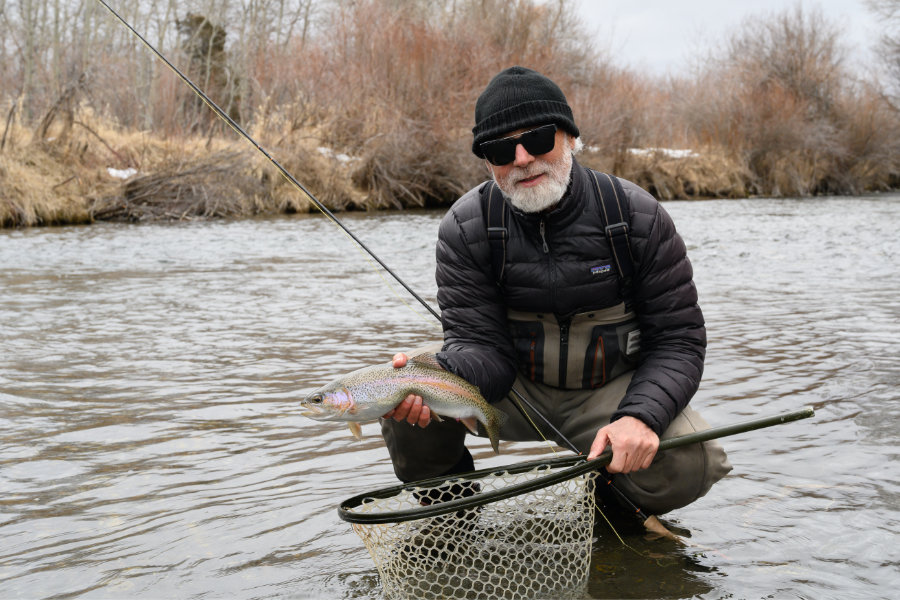 angler with a rainbow trout on DePuy's Spring Creek in Montana