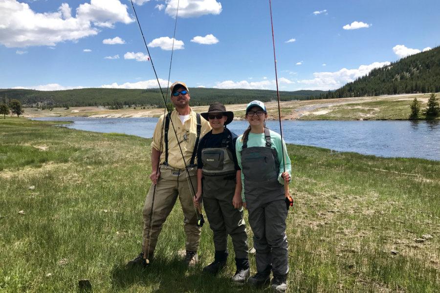 Family fly fishing in Montana