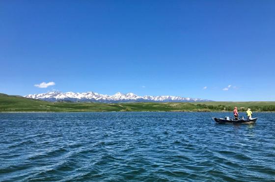 angler fly fishing on private lake near Bozeman