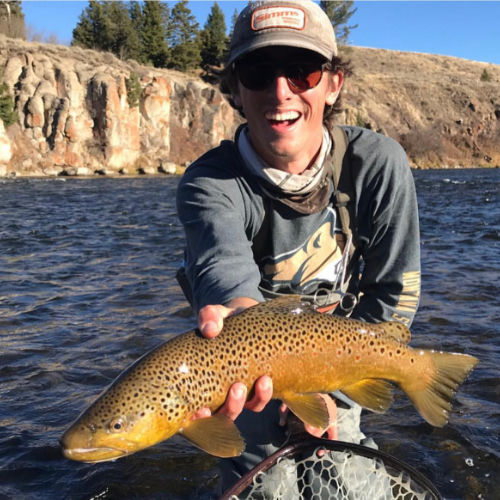 Montana fly fishing guide Spencer Wallace with trout