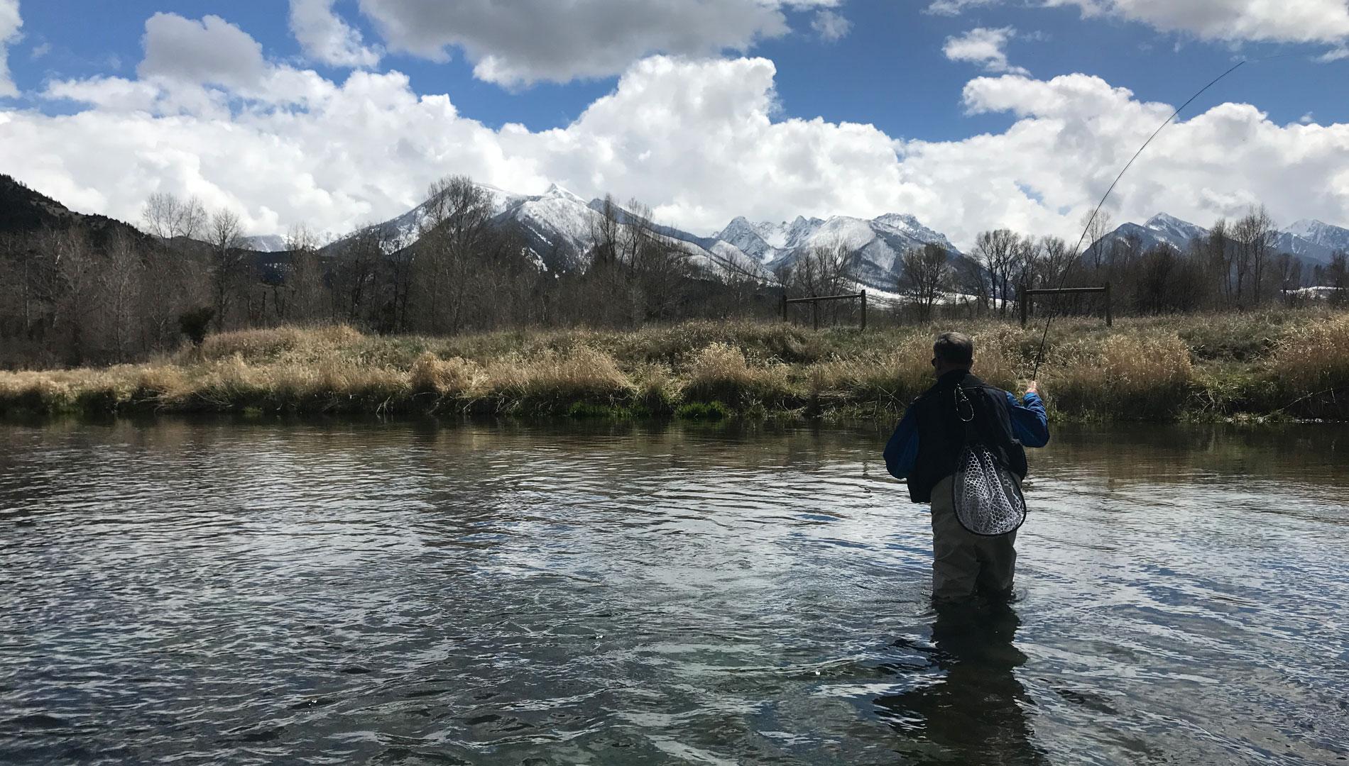 Angler fly fishing in April on DePuy's Spring Creek