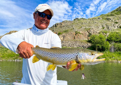 Angler with a brown trout on Montana's Missouri River