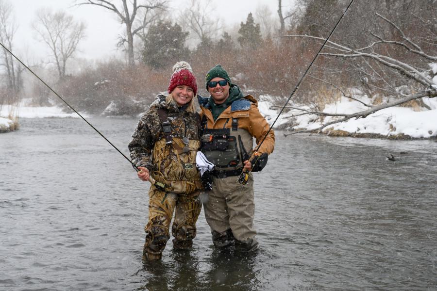 Angler couple enjoying winter fly fishing