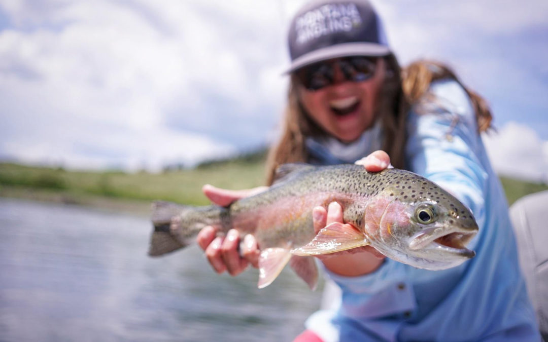 Angler with a rainbow trout on Montana's Missouri River in Spring